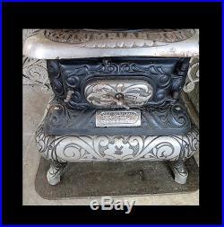 Ant Cast Iron Keeley Stove Co Pa. Model Columbian Joy Parlor Stove wood burning
