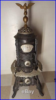 Antique BUCK cast iron parlor stove Beautiful ornate details