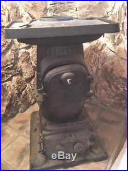 Antique Estate brand cast iron cook stove circa 1905. Vintage stove