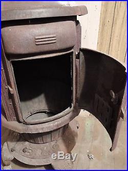 Antique ROUND OAK Cast Iron Wood Burning Stove