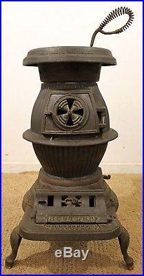 Antique W. M. Landers Hustler Cast Iron Coal Burning Pot Belly Stove