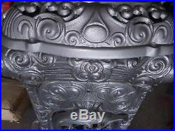 Antique cast iron parlor stove extremely ornate