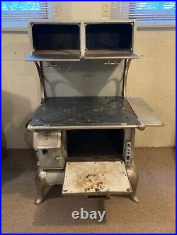 Antique wood burning cook stove with warmer