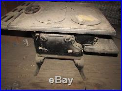 NOS RARE Antique WOOD STOVE by PERFECT CAST IRON 4 Burner OVEN ornate long legs