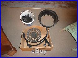 Round Oak antique cast iron stove. Approx. 23L X 23W X 67H